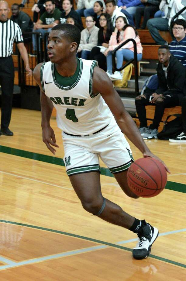 Rommell Williams (4) of Mayde Creek drives toward the paint during pool play of the Katy Classic Basketball Tournament between the Mayde Creek Rams and the Tomball Cougars on Thursday, December 5, 2019 at Mayde Creek HS, Houston, TX. Photo: Craig Moseley, Houston Chronicle / Staff Photographer / ©2019 Houston Chronicle
