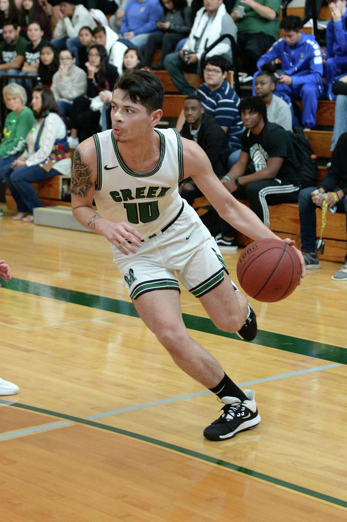 David Chavez (10) of Mayde Creek drives toward the paint during pool play of the Katy Classic Basketball Tournament between the Mayde Creek Rams and the Tomball Cougars on Thursday, December 5, 2019 at Mayde Creek HS, Houston, TX.