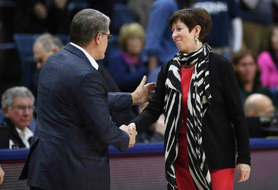 Notre Dame head coach Muffet McGraw, right, shakes hands with UConn head coach Geno Auriemma at the end of Sunday's game in Storrs. Photo: Jessica Hill / Associated Press / AP2019