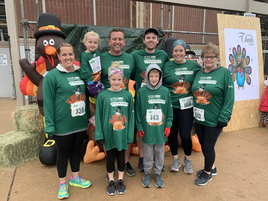 Turkey Trot: Monica Paul, back from left, Brynlee Paul, Jeff Paul, Denton O'Neil, Julia O'Neil and Carolyn Wood; and Bella Paul, front left, and Carson Paul Photo: Courtesy Photo