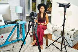 Shan Boodram, who has more than 500,000 online followers and a deal to make a show for the mobile video platform Quibi, records a video in her home in Los Angeles, Nov. 22, 2019. To entice subscribers, the founders of Quibi have ordered big-budget shows from known quantities like Kevin Hart and Steven Spielberg — but they have turned to social media stars for the kind of casual, low-commitment programming that could make Quibi a daily habit. (Michelle Groskopf/The New York Times)