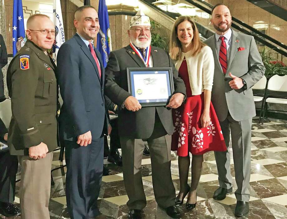 Lt. Gov. Susan Bysiewicz, second from right, and Department of Veterans Affairs Commissioner Thomas Saadi, second from left, inducted 10 veterans into the Connecticut Veterans Hall of Fame as the Class of 2019, including Morton Melvin Pear of Middletown, center. Photo: Contributed Photo