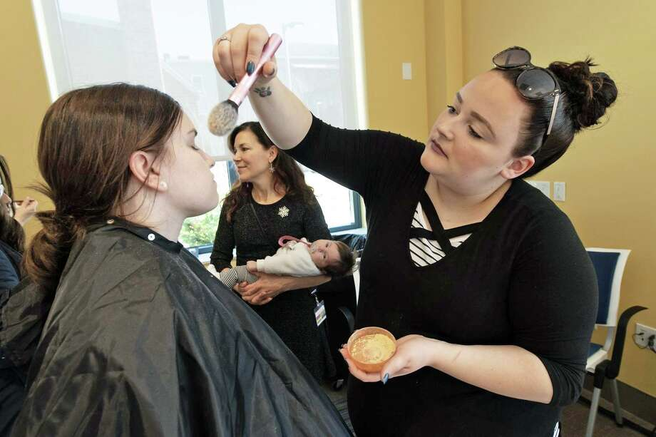 The Community Health Center of Middletown hosted its annual Help-Portrait event at the clinic, 675 Main St., Saturday. The initiative provides professional photographers and makeup artists to community residents for professional family portraits. Photo: Contributed Photo