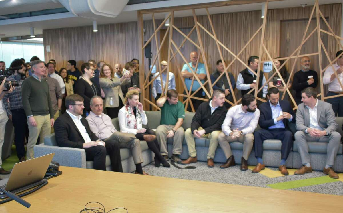 FactSet employees and visitors listen to CEO Phil Snow on the company's first day in its new headquarters at 45 Glover Ave. in Norwalk, Conn.