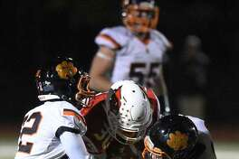 Senior defensive back Alex Hanna (left, #22) was among the Ridgefield football players earning All-FCIAC honors.
