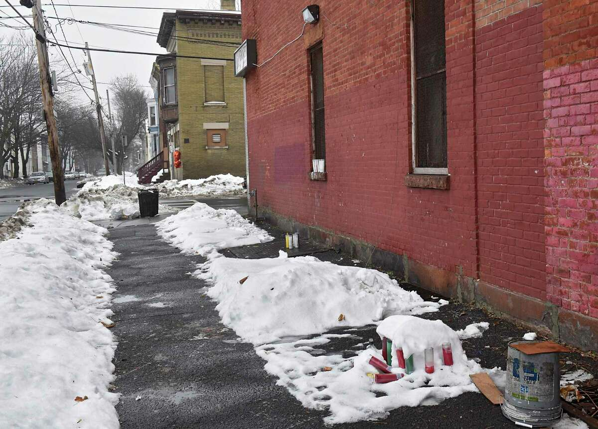 A memorial is seen in the distance near the intersection of Second and Judson streets where Ahmad Fleming was fatally shot in the abdomen Monday, Dec. 9, 2019 in Albany, N.Y. The shooting happened on Saturday. Older memorials from previous shootings are seen in the foreground. (Lori Van Buren/Times Union)