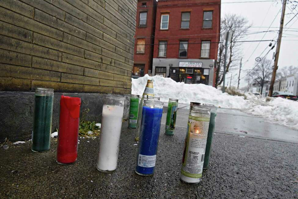 Lit candles make up part of a memorial seen near the intersection of Second and Judson streets where Ahmad Fleming was fatally shot in the abdomen Monday, Dec. 9, 2019 in Albany, N.Y. The shooting happened on Saturday. (Lori Van Buren/Times Union)