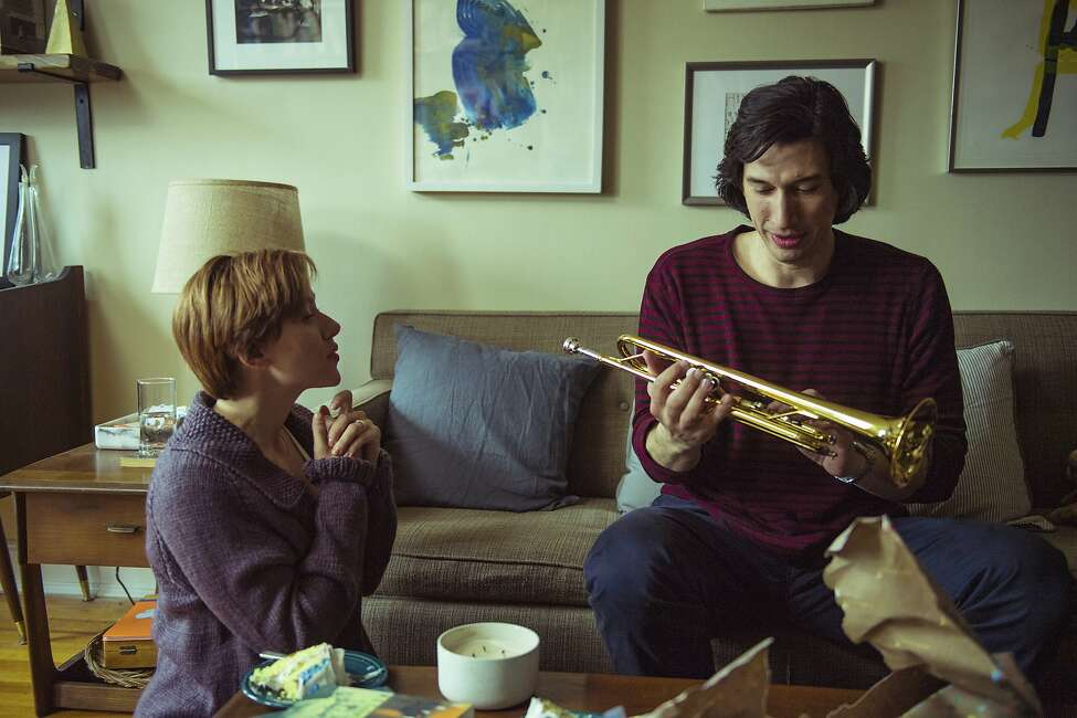 This image released by Netflix shows Scarlett Johansson, left, and Adam Driver in