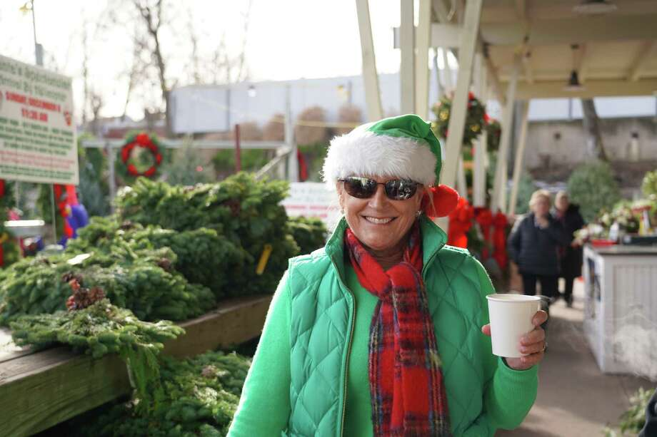 Santa landed by helicopter at Waveny Park and rode in a fire truck to Gregg's Garden Center and Landscaping, LLC, where elf Tucker Murphy and all the guests enjoyed refreshments on Sunday, Dec. 8. Photo: Grace Duffield / Hearst Connecticut Media