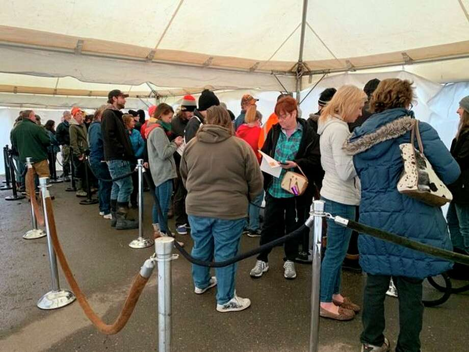 Customers waited in line under a tent provided by Lume Cannabis Company -- owner of Lit Provisioning Center in Evart. Lit began selling recreational-use marijuana on Friday, Dec. 6. (Star photo/Cathie Crew)