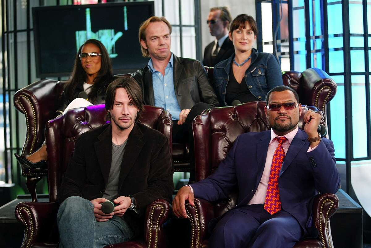 NEW YORK - MAY 13: (U.S. TABS OUT) (L to R from top) Jada Pinkett Smith, Hugo Weaving, Carrie-Anne Moss, Keanu Reeves and Laurence Fishburne during a visit from the cast of