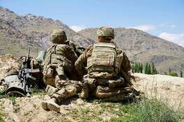 In this file photo taken on June 6, 2019, US soldiers look out over hillsides. Senior US officials insisted that progress was being made in Afghanistan despite clear evidence the war there had become unwinnable, The Washington Post reported on December 9, 2019 after obtaining thousands of US government documents on the conflict.(Photo by THOMAS WATKINS/AFP via Getty Images)