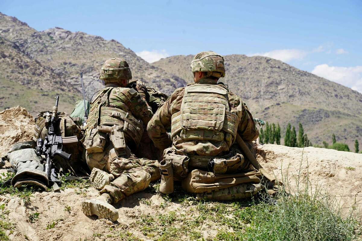 In this file photo taken on June 6, 2019, US soldiers look out over hillsides in Afghanistan. (Photo by THOMAS WATKINS/AFP via Getty Images)