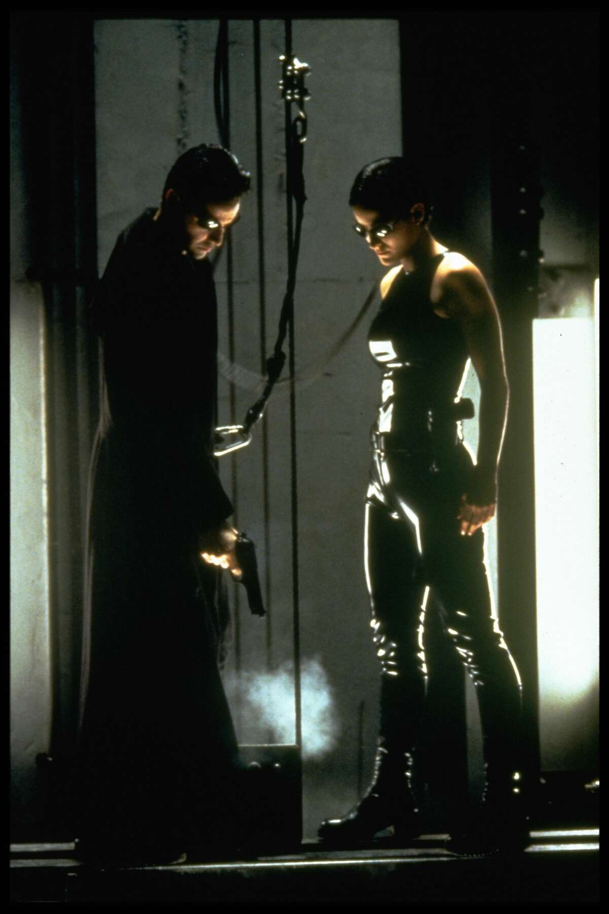 Keanu Reeves and Carrie-Anne Moss in The Matrix.