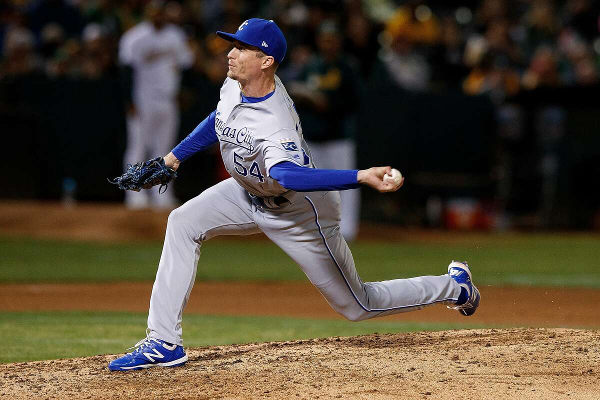 OAKLAND, CA - SEPTEMBER 16: Tim Hill #54 of the Kansas City Royals pitches against the Oakland Athletics during the fifth inning at the RingCentral Coliseum on September 16, 2019 in Oakland, California. The Kansas City Royals defeated the Oakland Athletics 6-5.