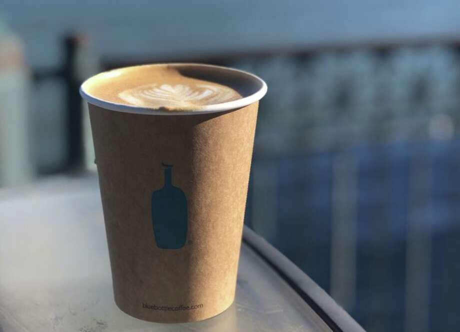 Disposable cups like this one may no longer be sold at Blue Bottle by the end of next year, the coffee roaster's CEO Bryan Meehan announced Monday. The company will start with a pilot program at two Bay Area cafés. Photo: Judy D. Via Yelp