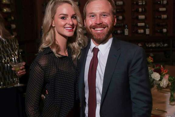 Sarahbeth and Pierce Bush pose for a photograph during a dinner party at Tony's on Tuesday, Oct. 8, 2019, in Houston.