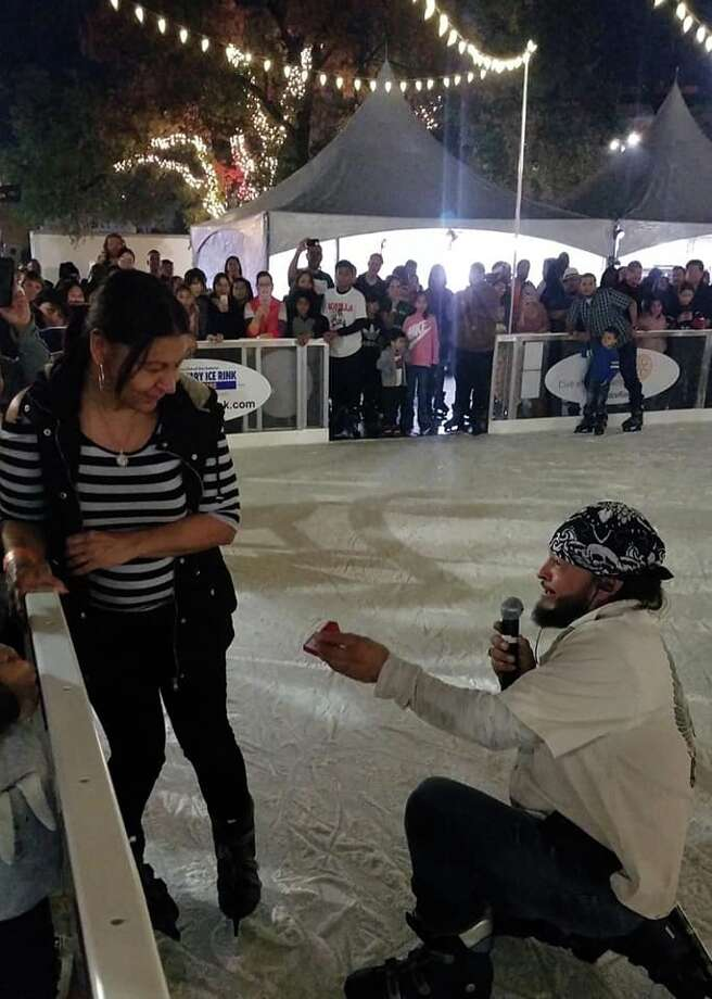 After being together for more than 11 years, Danny Torres, 43, proposed to his longtime girlfriend Chrissy Ruiz, 54, Sunday at the local outdoor ice skating rink that he helped build at Travis Park. Photo: Facebook: Genevieve Chi