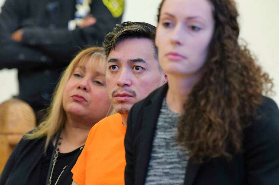 Anthony Ojeda, center, appears in Cohoes City Court with his attorney, Albany County Assistant Public Defender, Angela Kelley, right, for a preliminary hearing on Monday, Dec. 9, 2019, in Cohoes, N.Y. (Paul Buckowski/Times Union)