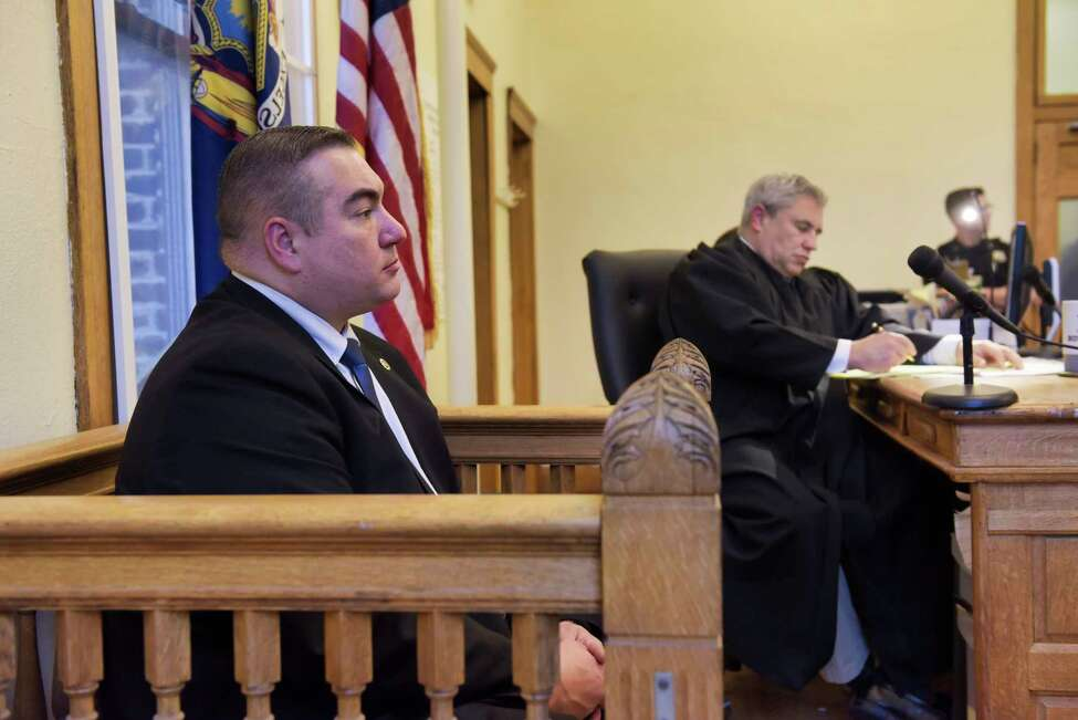 Cohoes Detective Michael Greene, left, testifies at a preliminary hearing for defendant, Anthony Ojeda, in the courtroom of Judge Thomas Marcelle on Monday, Dec. 9, 2019, in Cohoes, N.Y. (Paul Buckowski/Times Union)