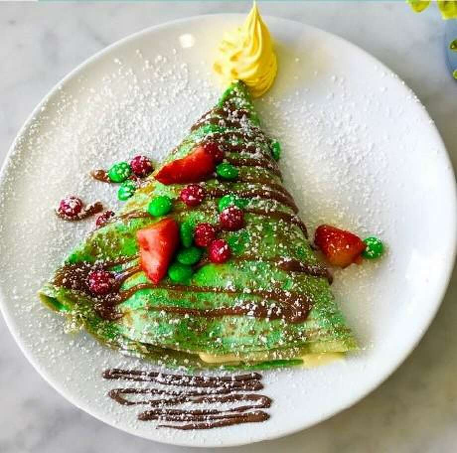 Eating at local restaurants and eateries helps support the Houston economy and create jobs. Right now, Sweet Paris Creperie and Cafe is serving The Grinch crepe. Photo: Courtesy BySweet Paris Creperie And Cafe