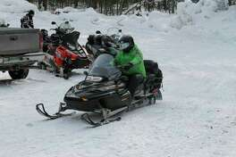 Manistee County offers 250 miles of groomed snowmobiling trails, plus access to more tore than 500 miles in a five-county trail network. (News Advocate file photo)