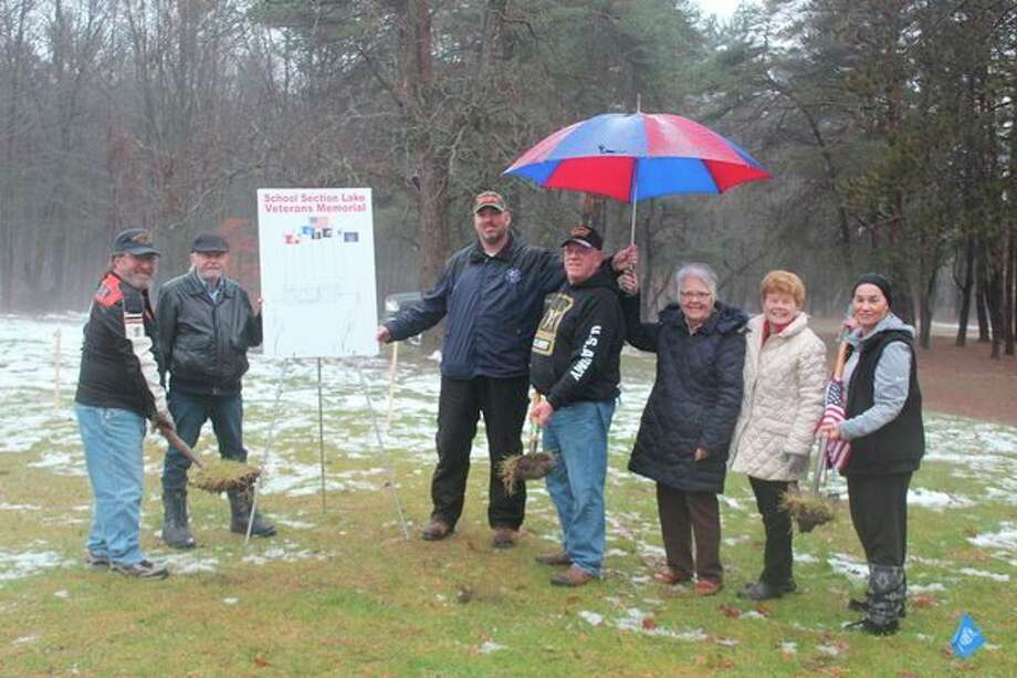 The School Section Lake Veterans Park Memorial Project Committee broke ground on a veterans memorial Monday morning. The group plans to have the memorial completed before the campground opens May 1, 2020. (Pioneer photo/Catherine Sweeney)