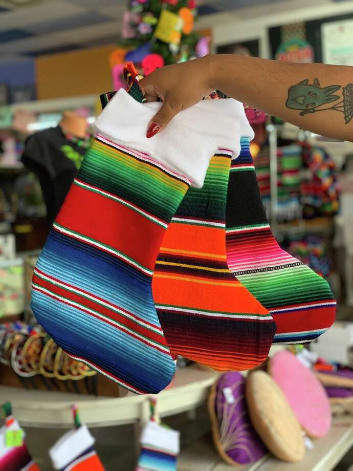 Serape stockings are now available at Karolina's Antiques. The line is designed by Anthony Diaz, one of Karolina's Antique's in-house artists. The store also recently started selling serape jackets and vests. Photo: Courtesy, Karolina's Antiques
