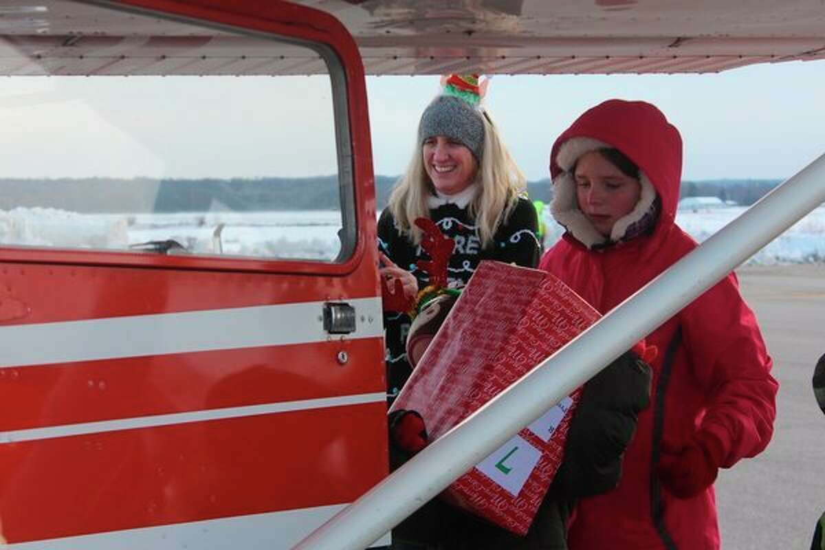 Beginning at 9 a.m., volunteers unloaded more than 30 planes at Roben-Hood Airport. (Herald Review photo/Catherine Sweeney)