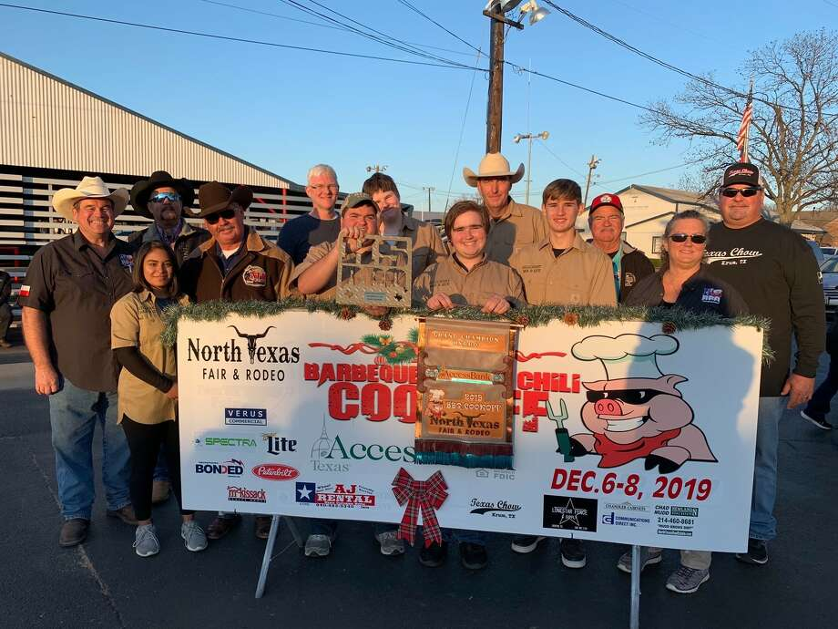 Hillcrest Eagle-Q barbecue team poses with grand championship award with judges on 12/7/2019 in Denton. The team includes Olivia Ingram, Ryan McDaniel, Cameron Williams, Garrett Stephenson, sponsor Steve Fourqurean and Tyler Hass (left to right in uniform). Photo: Courtesy Of Hillcrest