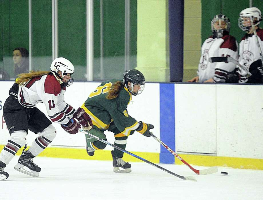 At right, Grace Schulze of Greenwich Academy (6) beats Loomis Chaffee defender Jess Schryver (10) to the puck during the girls high school ice hockey game between Greenwich Academy and Loomis Chaffee School at Chelsea Piers in Stamford last season. Photo: Hearst Connecticut Media File Photo / Greenwich Time