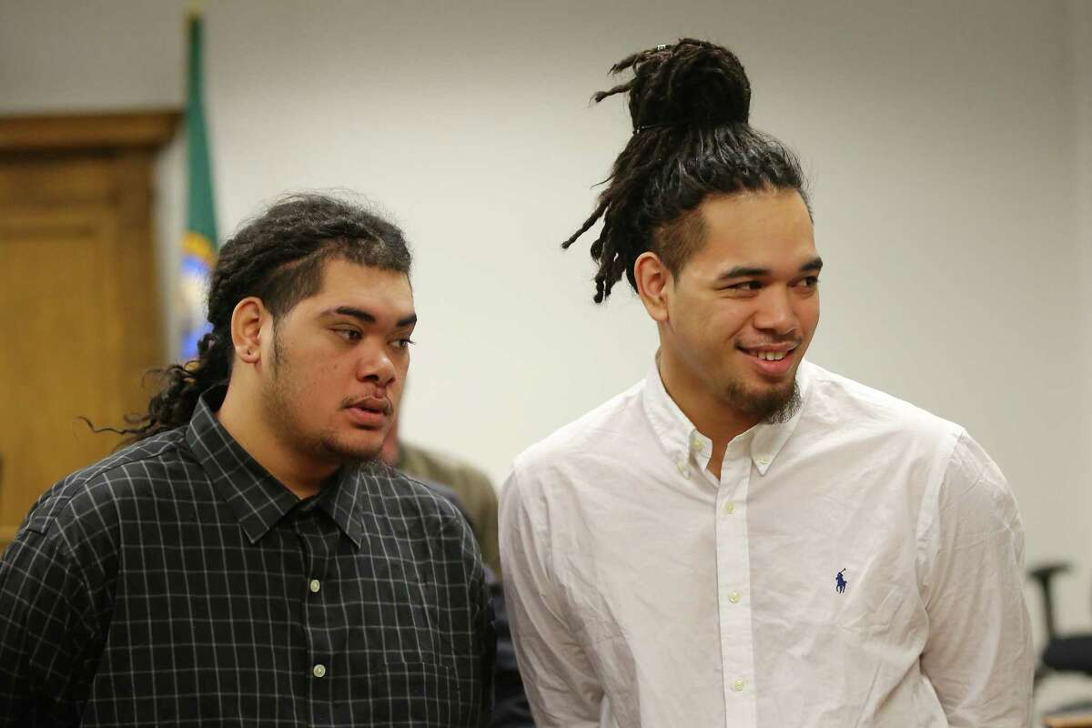 James and Jerome Taafulisia, who were accused of killing two people in the jungle homeless encampment slaying in January 2016, stand up during a break in closing statements during their third murder and assault trial, Dec. 9, 2019 at the King County Superior Courthouse.
