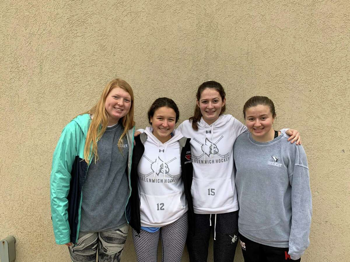 From left to right, Sydney Orszulak, Emma Wingrove, Katie Piotrzkowski and Jessica Marzullo are senior captains of the Greenwich High girls ice hockey team.