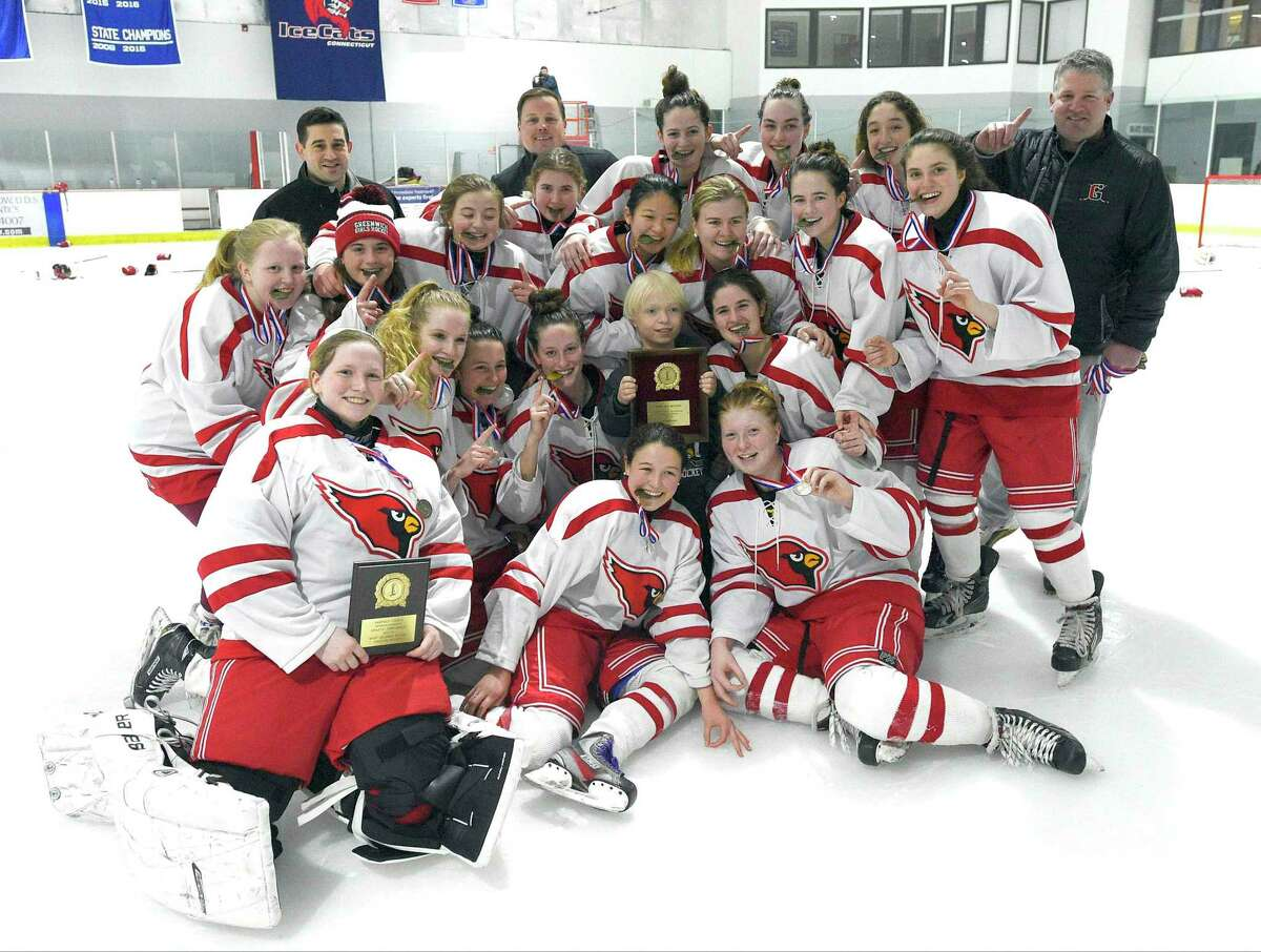 Greenwich celebrates a 2-1 win over New Canaan for its second FCIAC girls ice hockey championship title at the Darien Ice Rink on Feb. 24, 2018 in Darien.