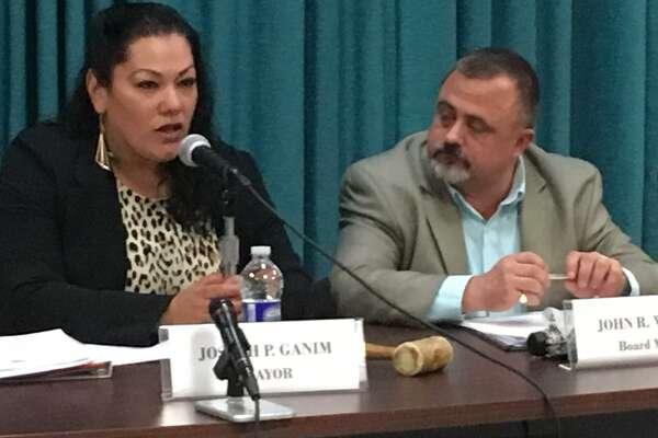 New Bridgeport Board of Education Chairman Jessica Martinez and John Weldon, former chair. Monday Dec. 9, 2019