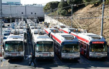 Retired trolley buses, at left, are arranged next to the newest models at Muni's Presidio maintenance yard in San Francisco, Calif. on Friday, Oct. 4, 2019. The transit agency has completed its program to replace older trolley buses, first entering service in 2001, with a newer fleet of fully electric models that can operate for longer periods independent of the overhead wires.