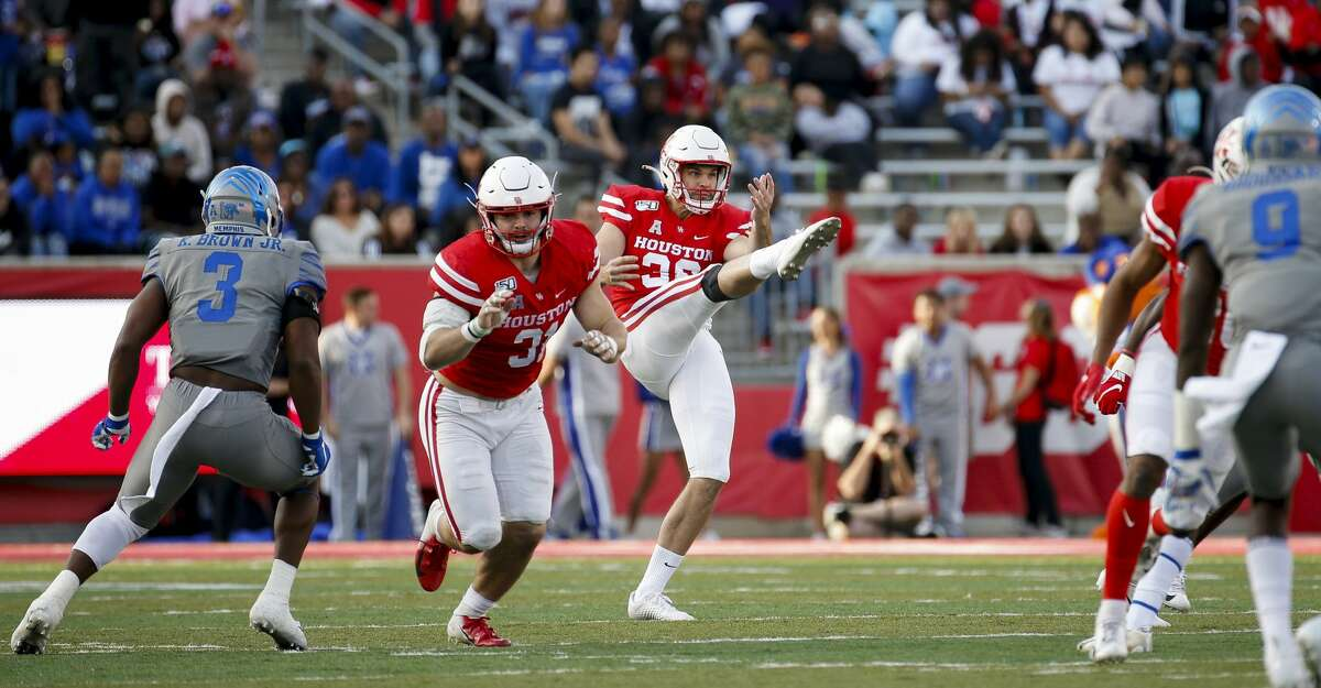 Houston Cougars punter Dane Roy (38) punts the ball against the Memphis Tigers during the second quarter of an NCAA game at TDECU Stadium Saturday, Nov. 16, 2019, in Houston. Memphis won 45-27.