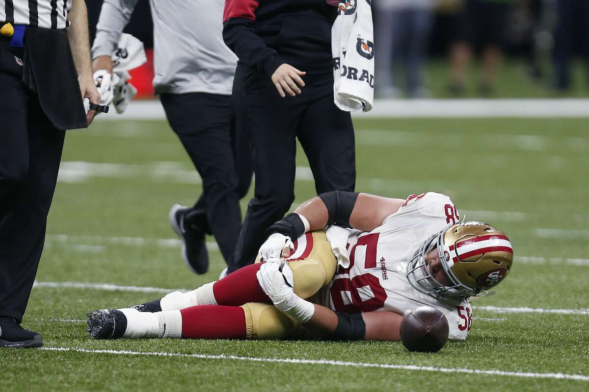 San Francisco 49ers center Weston Richburg (58) holds his knee after being injured in the second half an NFL football game against the New Orleans Saints in New Orleans, Sunday, Dec. 8, 2019. (AP Photo/Butch Dill)