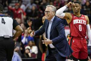Houston Rockets coach Mike D'Antoni, center, yells at the officials as Russell Westbrook (0) watches during the first half of an NBA basketball game against the Dallas Mavericks Sunday, Nov. 24, 2019, in Houston. (AP Photo/David J. Phillip)