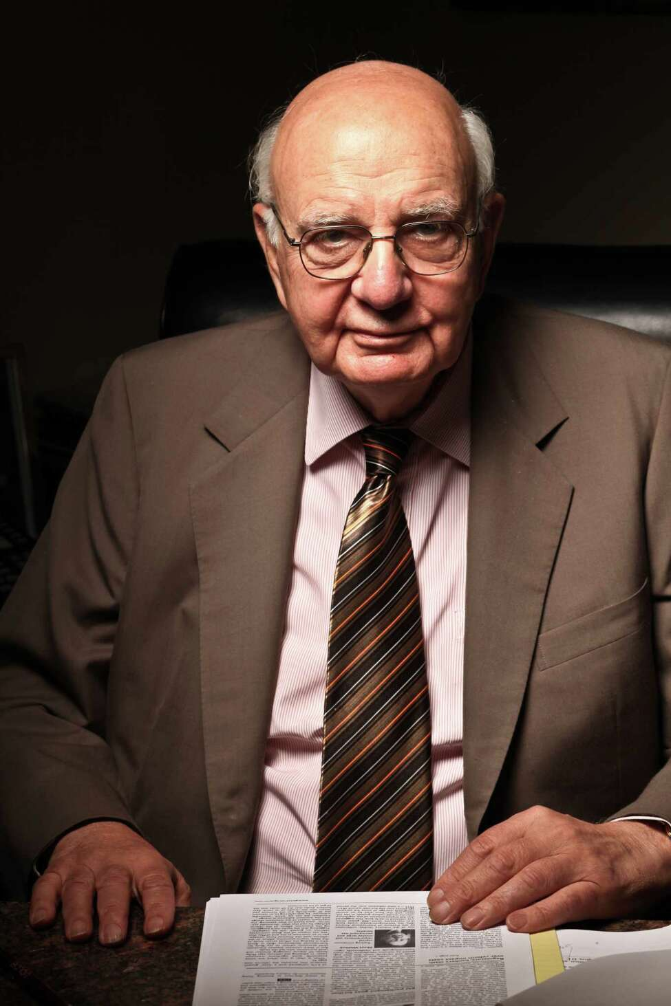 FILE -- Economist and former Federal Reserve Chairman Paul Volcker in his office in New York on June 28, 2010. Volcker, who helped shape American economic policy for more than six decades, most notably by leading the Federal Reservea€™s brute-force campaign to subdue inflation in the late 1970s and early 1980s, died on Sunday, Dec. 8, 2019, in New York. He was 92. (Fred R. Conrad/The New York Times)