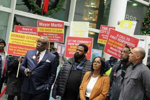 From left, the Rev. Tommie Jackson, with other advocates at Government Center, calls on city leaders for accountability regarding the death of 23-year-old Steven Barrier, who died while in police custody. Steven Barrier's parents, Steven Barrier Sr. and Valerie Jaddo, middle, attend the rally.
