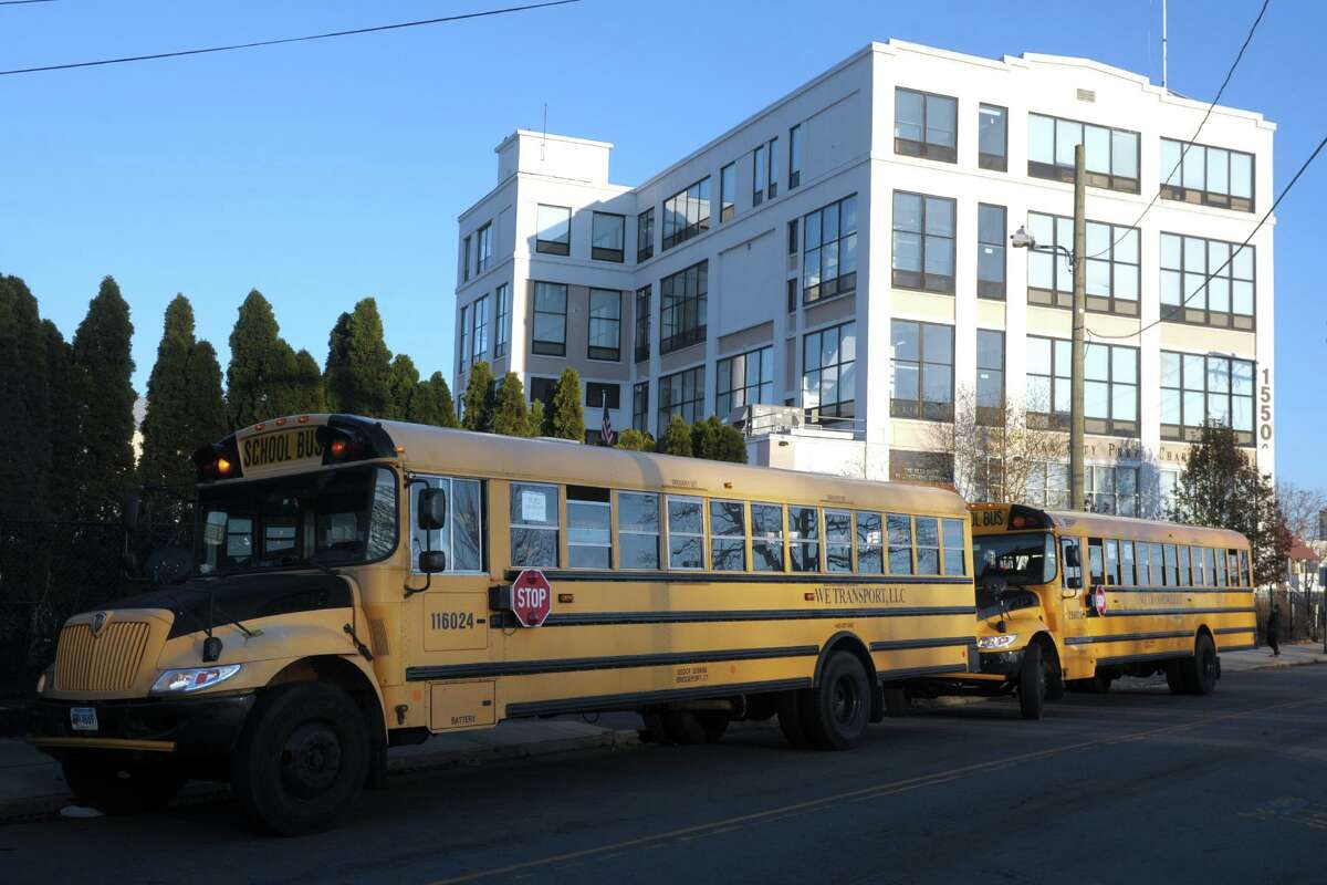 School buses line up along Mountain Grove Street at the end of the school day at Park City Prep Charter School in Bridgeport last year.