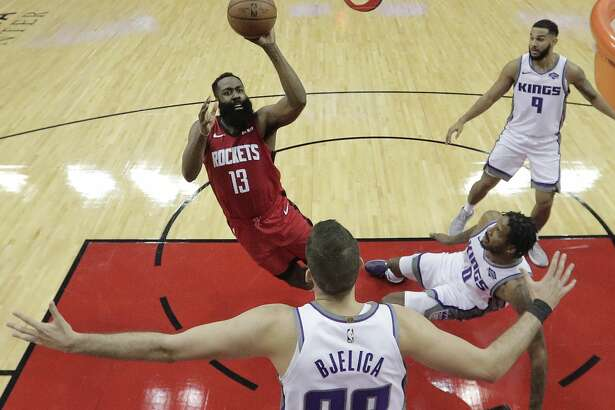 Houston Rockets guard James Harden (13) takes a shot over Sacramento Kings forward Nemanja Bjelica (88) during the first half of an NBA basketball game at Toyota Center on Monday, Dec. 9, 2019, in Houston.