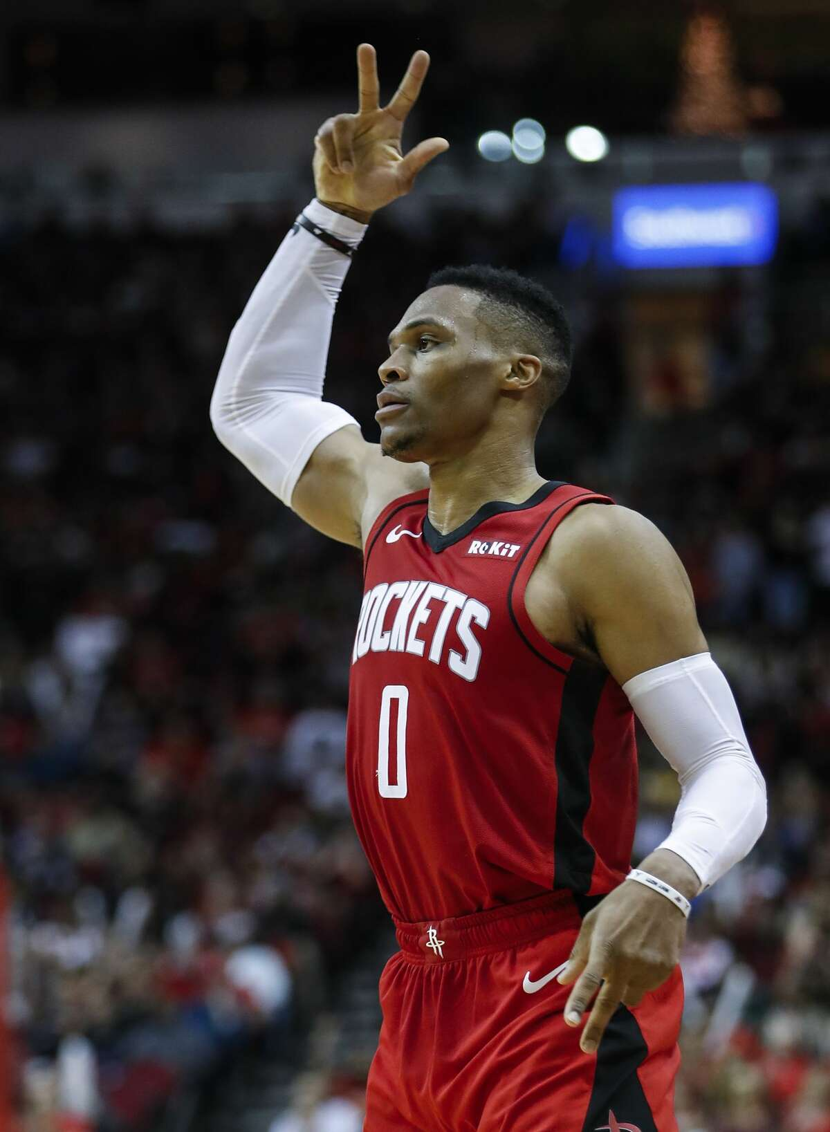 Houston Rockets guard Russell Westbrook (0) reacts after hitting a 3-pointer over Sacramento Kings forward Richaun Holmes (22) during the first half of an NBA basketball game at Toyota Center on Monday, Dec. 9, 2019, in Houston.