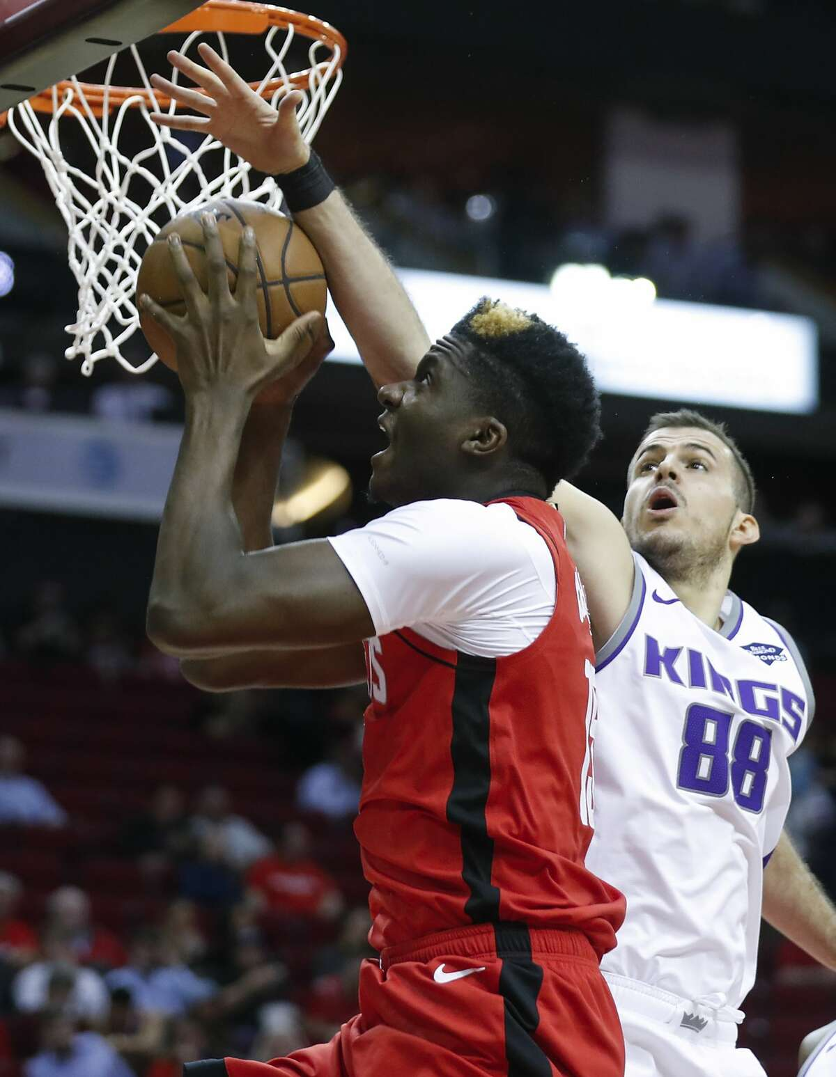 Houston Rockets center Clint Capela (15) takes a shot with Sacramento Kings forward Nemanja Bjelica (88) defending during the first half of an NBA basketball game at Toyota Center on Monday, Dec. 9, 2019, in Houston.