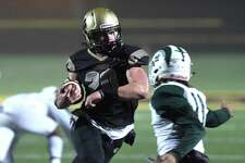 Hand's Colin McCabe cuts through the Maloney defense for a touchdown early in the first half on Monday.