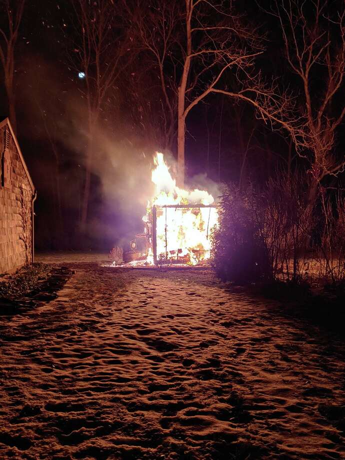 Just after midnight on Saturday morning, Shelton fire companies 3, 5, and 1 responded to a shed fire on Beverly Lane. Crews quickly extinguished the fire and prevented it from extending to the nearby residence. Photo: Shelton Fire Department / Contributed Photo / Connecticut Post