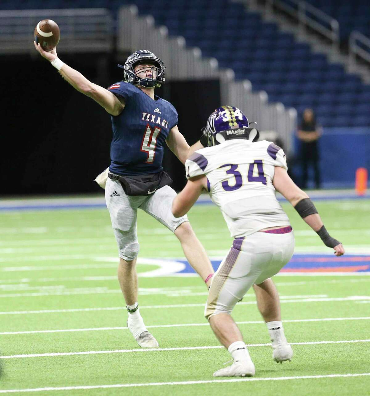 Wimberley quarterback Cooper McCollum (04) throws the ball against Navarro's Gabriel Means (34) during their state quarterfinals football game at the Alamodome on Friday, Dec. 6, 2019.