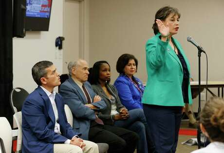Cynthia Brehm (right) addresses an audience in 2015, when she ran for mayor, as other candidates Mike Villarreal (from left), Rhett Smith, then-Mayor Ivy Taylor and Leticia Van de Putte listen. Brehm's leadership of the Bexar County Republican Party is now being openly challenged by other elected Republicans and party activists. (Kin Man Hui/San Antonio Express-News)