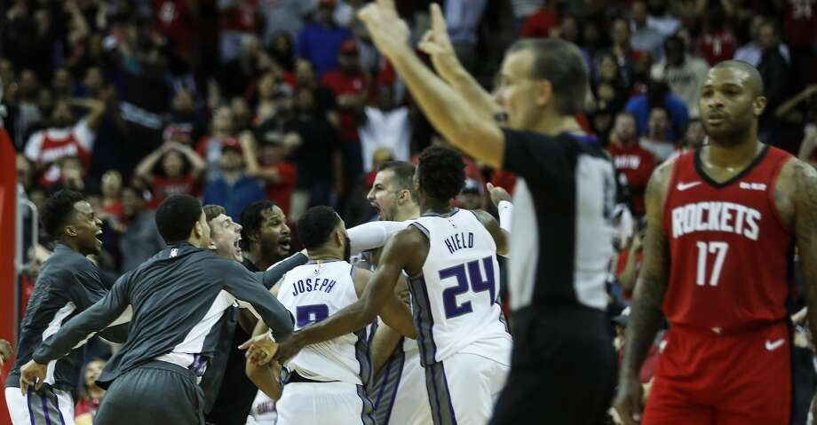 The Sacramento Kings players mob Sacramento Kings forward Nemanja Bjelica (88) after he hit a game-winning 3-pointer as time ran out to beat the Houston Rockets 119-118 in an NBA basketball game at Toyota Center on Monday, Dec. 9, 2019, in Houston. Photo: Brett Coomer/Staff Photographer
